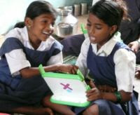 Indian Children exploring OLPC XO laptop