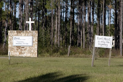 The Dove compound sign and another warning 'Fort Hood is only the beginning'