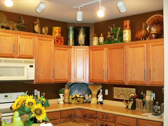 A Stroll Thru Life: Small Changes to the Cabinet Top Displays - Decorating Top Of Cabinets With Sunflowers
