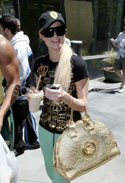 507b98b913b1 Look how smiley she's when carrying her puppy dog and her sumptuous Prada  leather tote.