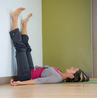 cowgirl yoga onepose wonder shoulder stand at the wall