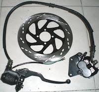 Sparepart sepedamotor murah. Rem cakram depan Suzuki Thunder125.