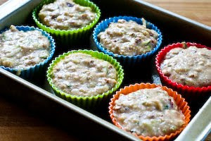 filling muffin cups for Low-Sugar and Flourless Zucchini Muffins with Pecans (Gluten-Free) found on KalynsKitchen.com