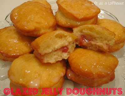 Glazed Jelly Doughnuts are soft and delicious homemade doughnuts filled with jelly and topped with a tasty glaze. Life-in-the-Lofthouse.com