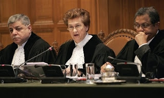 From left: Vice-President of the Court Judge Awn Shawkat Al-Khasawneh, British President of the Court, Judge Rosalyn Higgins and Judge Raymond Ranjeva at the International Court of Justice, also known as the World Court, in The Hague, the Netherlands, Monday Feb. 26, 2007. The United Nations' highest court ruled that Serbia failed to use its clear influence with Bosnian Serbs to prevent the genocide of Bosnian Muslims at Srebrenica, but exonerated Serbia of direct responsibility for genocide or complicity in genocide in Bosnia during the 1992-95 war. The court began delivering a historic ruling Monday on whether Serbia is responsible for genocide through the killing, torture, rape and expulsion of Bosnian Muslims. It is the first time an entire nation is being held to judicial account for the ultimate crime.