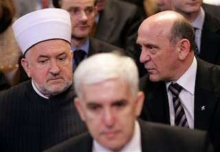 Head of the Islamic Community in Bosnia and Herzegovina Mustafa Ceric, left, Bosnian agent Sakib Softic, front center, and former Bosnia president, Sulejman Tihic, right, now head of Bosnia's Party for Democratic Action, speak at the International Court of Justice, also known as the World Court, in The Hague, the Netherlands, Monday Feb. 26, 2007. The United Nations' highest court ruled that Serbia failed to use its clear influence with Bosnian Serbs to prevent the genocide of Bosnian Muslims at Srebrenica, but exonerated Serbia of direct responsibility for genocide or complicity in genocide in Bosnia during the 1992-95 war. The court began delivering a historic ruling Monday on whether Serbia is responsible for genocide through the killing, torture, rape and expulsion of Bosnian Muslims. It is the first time an entire nation is being held to judicial account for the ultimate crime.
