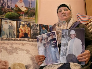 A Bosnian Muslim woman survivors of the Srebrenica massacre Sabra Mujic, 54,displays photographs of her loved ones who were killed in 1995 when Bosnian Serb forces took the enclave of Srebrenica, in her room in the Bosnian village of Podlugovi, near Sarajevo, Monday, Feb. 26, 2007. The United Nations' highest court on Monday exonerated Serbia of direct responsibility for the mass slaughter of Bosnian Muslims at Srebrenica during the 1992-95 Bosnia war, but ruled that it failed to prevent genocide.