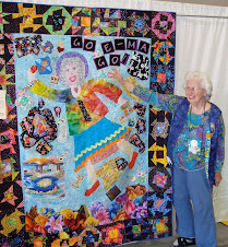 Jean Spencer shows off her darling story quilt