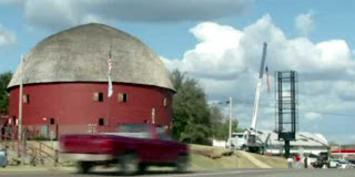 Billboard being erected beside Oklahoma's famous Round Barn