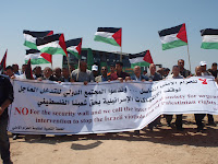 marching+with+banner - A Nonviolent Che Guevara in Gaza From THE ONLY DEMOCRACY)