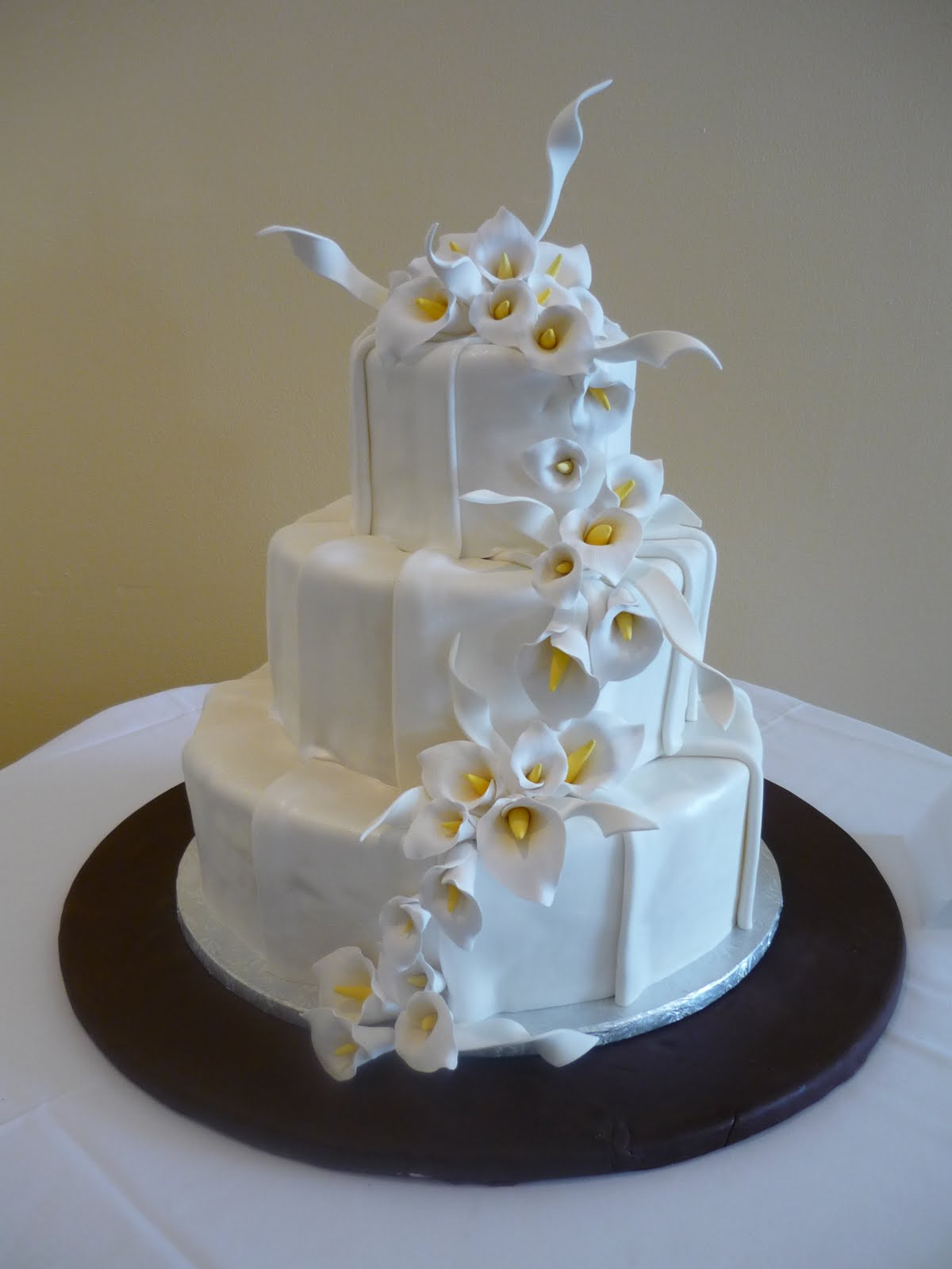 artisan bake shop  wedding cake  ruched pleats of fondant with victorian lavender tulips and