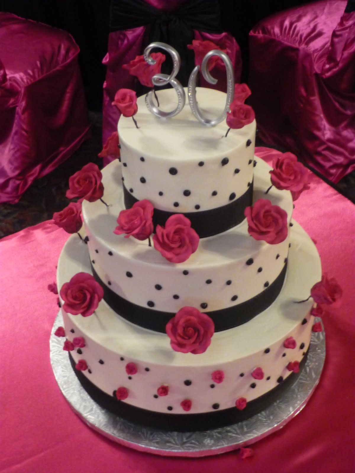 Sugar Roses In A Hot Raspberry Fushia Sit Above The Ledge Of Tiers Perched Black Wires 30 Monogram Topper Finishes Off Design