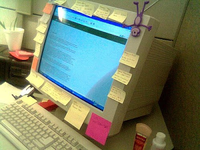 sticky notes surroudning computer screen