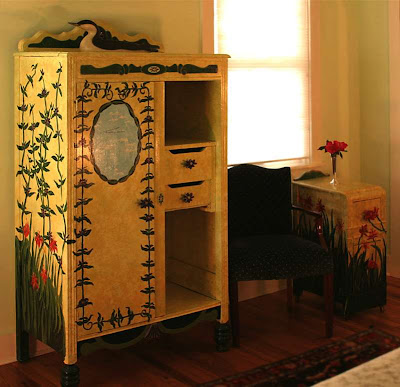 painted armoire with flowers on the side