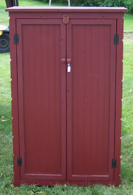 dark red cabinet from barn boards