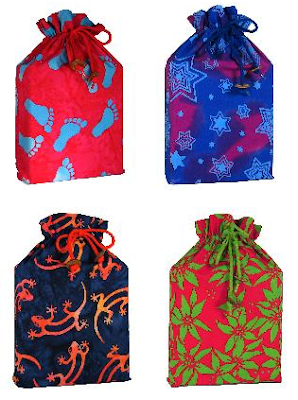 four fabric gift bags