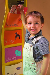 Zid Zid Kids colorful wall panel with pockets for each day of the week
