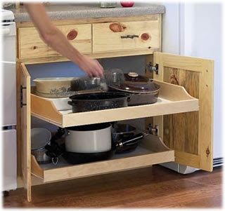 pull-out cabinet shelves holding pots and pans