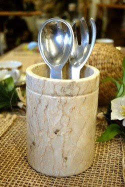 marble utensil holder with a couple things inside