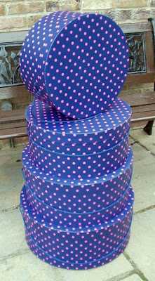 stack of blue hat boxes with pink polka dots