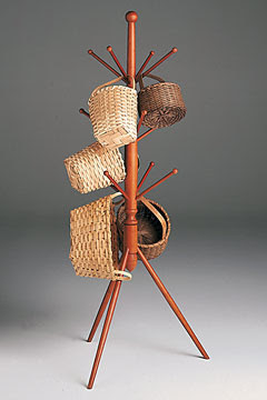 tripod coat stand, with baskets hanging from it