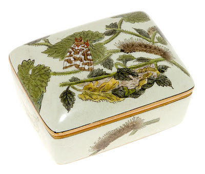 porcelain box showing metamorphosis to butterfly
