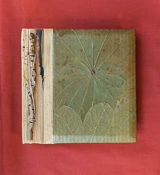 photo album with lily leaf on the cover