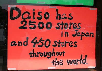 Daiso - hand-printed sign listing number of stores worldwide