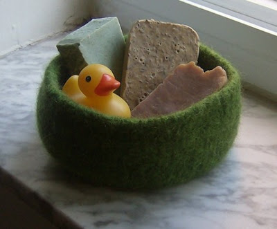 green felted bowl with soaps