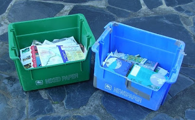 recycling bins filled with old travel literature