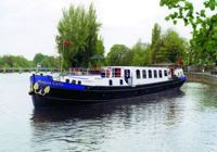 Hotel Barge Magna Carta cruises the River Thames in England. Contact Paradise Connections for booking details.