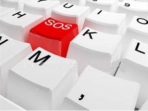 tastiera bianca, un tasto è rosso con scritto 'SOS'
