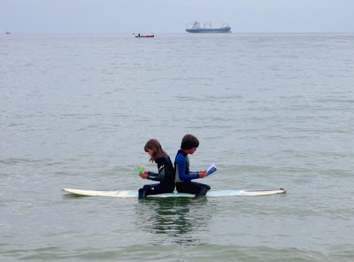 reading books on surfboard