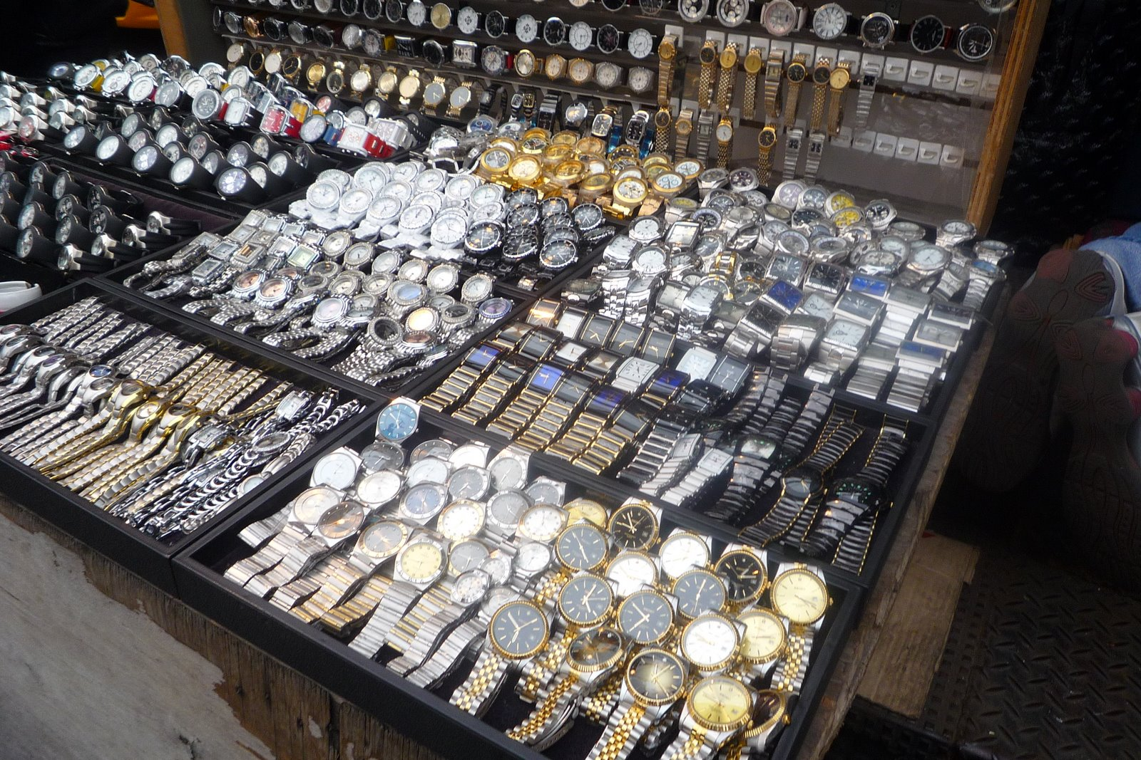 f19a1046a387 ... array of counterfeit watches on Canal Street. They have all the fake  stuff there. A lot of it is now hidden away
