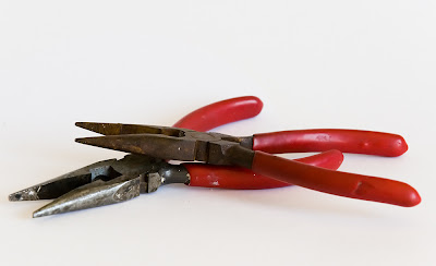two sets of plyers with red handles, free stock photo, copyright J.Gracey Stinson