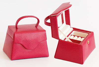 red faux leather jewel box in the shape of a handbag