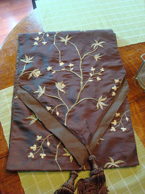 brown table runner with cream and green
