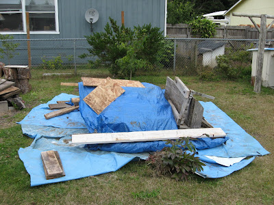 Placing plastic or tarps on grass will kill it, thus making digging easier