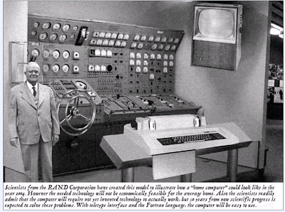 man standing with first generation computer