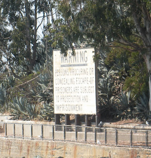 """Alcatraz warning: """"Persons procuring or concealing escape of prisoners are subject to prosecution and imprisonment"""""""