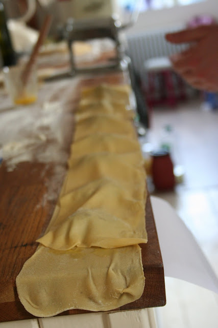 ravioli, sealing the parcels with egg