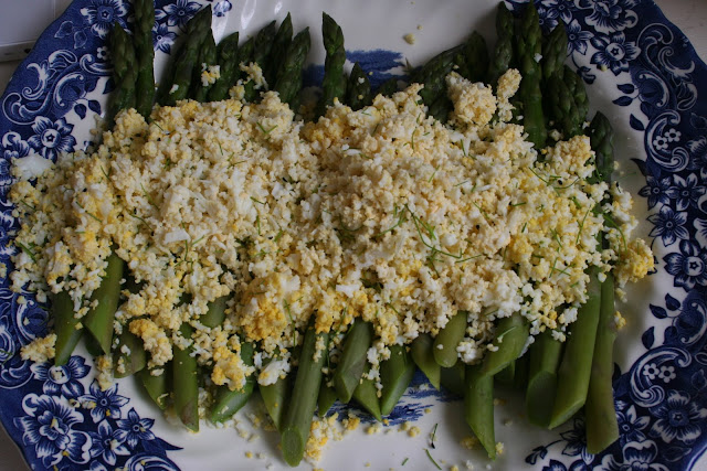 Asparagus mimosa, served with chives and sage butter, decorated with violas