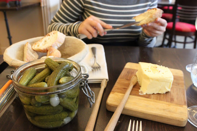 A lovely funky amuse-bouche: cornichons and onion pickles. Not home-made however. Carnivores get a big terrine of paté, we got some bread and butter., la regalade, paris