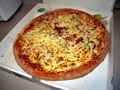 There are calories in a Large The Works Pizza from Papa John's. Most of those calories come from fat (37%) and carbohydrates (48%).