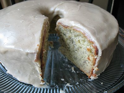 A close up photo of a bananas and cream Bundt cake with brown butter glaze.