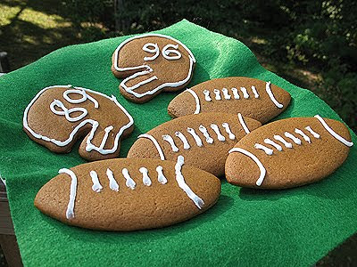 A close up photo of soft gingerbread football cookies.