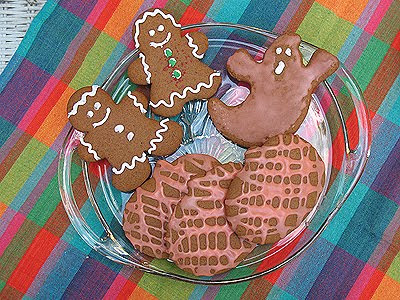 An overhead photo of soft gingerbread people, ghosts, and pumpkin cookies.