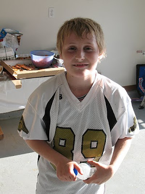 An old photo of Amanda\'s son Dominic at the end of season party in his football jersey.