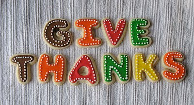 A close up photo of give thanks thanksgiving cookies.