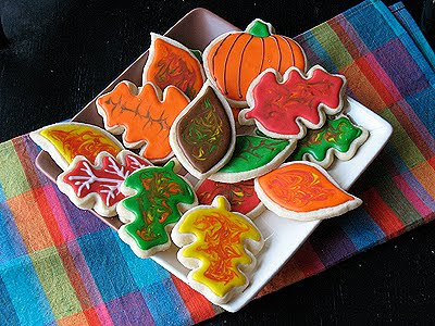 A photo of an assortment of thanksgiving cookies resting on a plate.